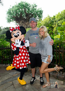 Carrie Underwood leggy promoting Olay,Vitamin Water and at Disney World x4